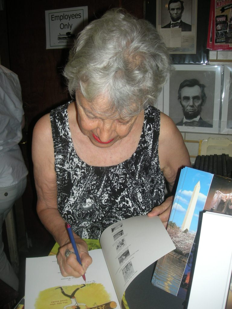Kay signing at Lincoln Memorial